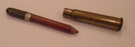 pencil hidden in rifle shell.png